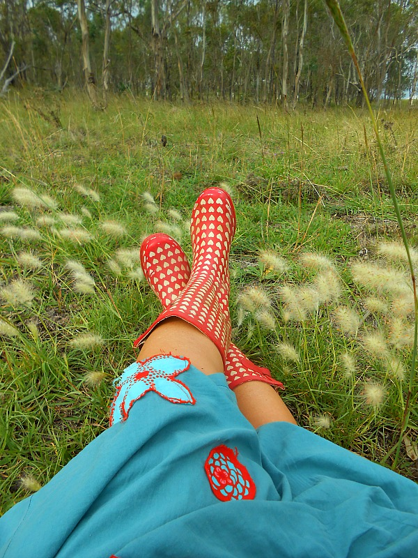red wellies in the grass